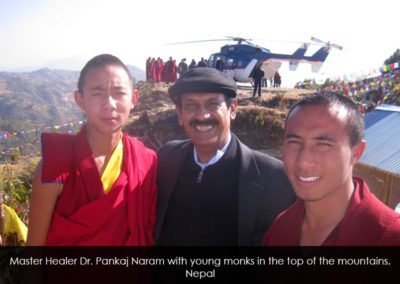 Master Healer  Pankaj Naram with young monks in the top of the mountains, Nepal